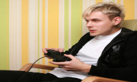 excited young adult playing videogame